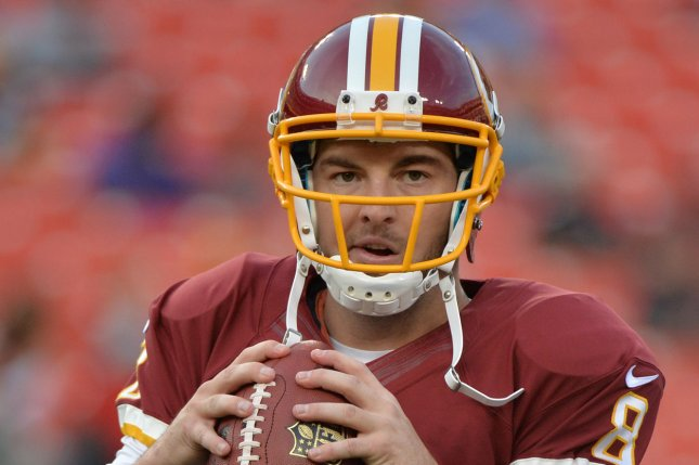 Washington Redskins quarterback Rex Grossman warms up prior to the Redskins game against the Pittsburgh Steelers in 2013. File Photo by Kevin Dietsch/UPI