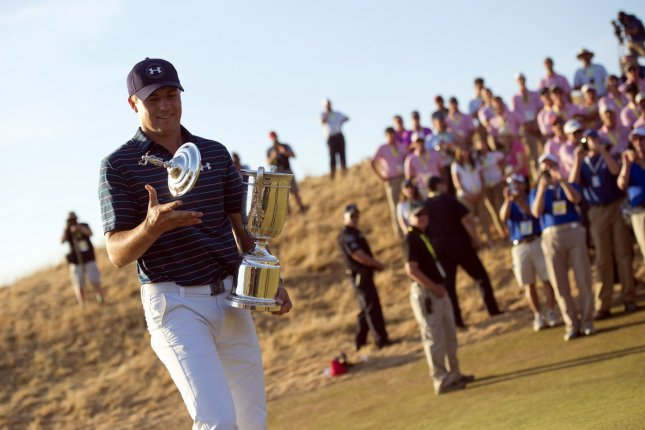 Jordan Spieth holds trophy after winning the 115th U.S. Open Championship at Chambers Bay on June 21, 2015 in University Place, Washington. Spieth won by one stroke with five under par. Photo by Kevin Dietsch/UPI