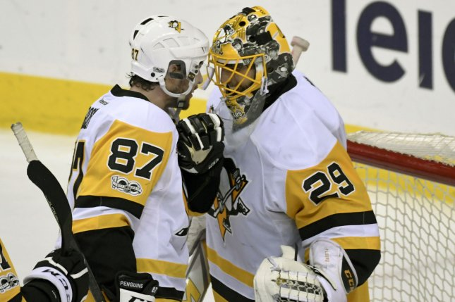 Pittsburgh Penguins center Sidney Crosby (87) congratulates goalie Marc-Andre Fleury (29) following the game against the Washington Capitals at the Verizon Center in Washington, D.C. on May 10, 2017, in game seven of the second round of the Stanley Cup Playoffs. File photo by Mark Goldman/UPI