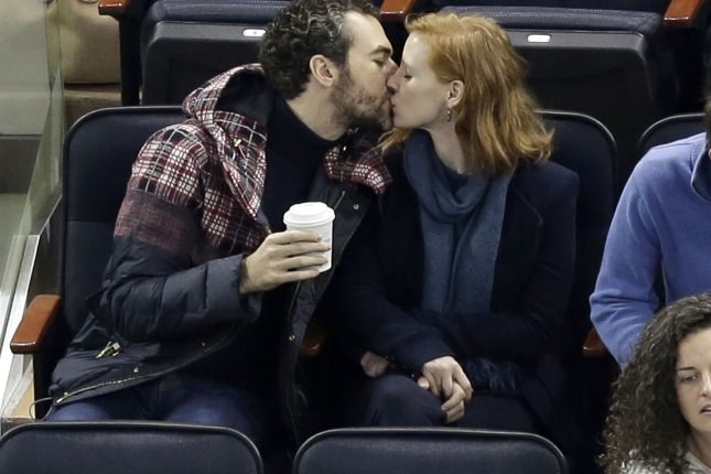 Jessica Chastain and Gian Luca Passi de Preposulo kiss as the Washington Capitals play the New York Rangers in New York City on January 9, 2016. The couple married in Italy this weekend after dating for five years. File Photo by John Angelillo/UPI