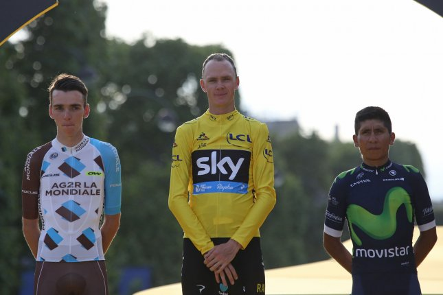 Romain Bardet (L) of France, Chris Froome of Great Britain (C) and Nairo Quintana of Columbia pause on the presentation podium after the Tour de France in Paris on July 24, 2016. File photo by David Silpa/UPI