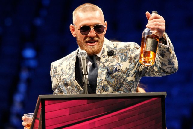Conor McGregor addresses the media with a bottle of his 'Notorious Whiskey' during the post-fight media conference of his super-welterweight fight with Floyd Mayweather Jr. on August 26 at T-Mobile Arena in Las Vegas, Nevada. File photo by James Atoa/UPI