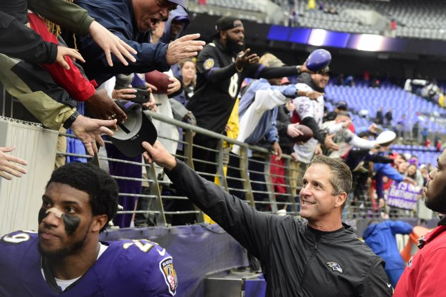 Baltimore Ravens head coach John Harbaugh celebrates with fans after a win over the Denver Broncos on September 23 at M&T Bank Stadium in Baltimore, Maryland. Photo by David Tulis/UPI