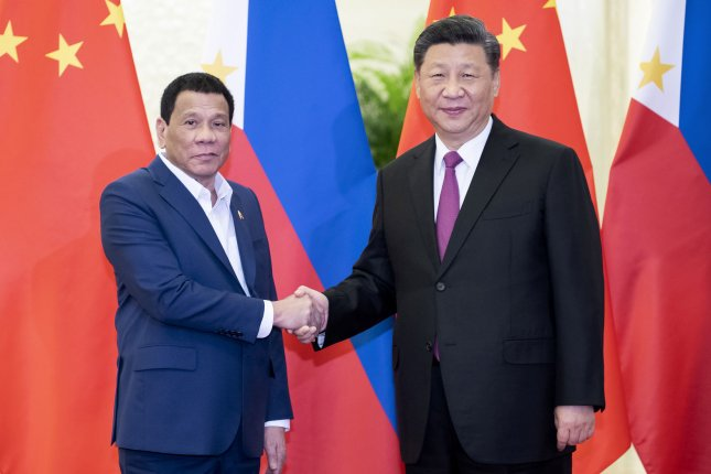 Philippines President Rodrigo Duterte is moving forward with projects involving Chinese firms under U.S. sanctions. File Pool Photo by Li Tao/UPI