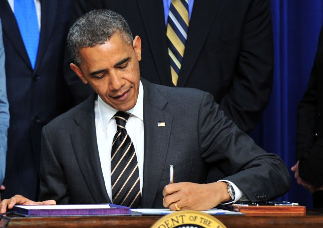 Obama signs STOCK Act into law