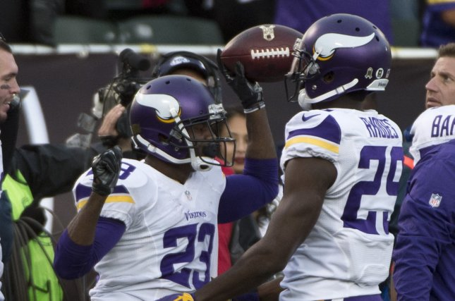 Minnesota Vikings Terrence Newman (23) is congratulated by Xavier Rhodes (29) after picking off a second pass from Oakland Raiders QB Derek Carr in the fourth quarter at O.co Coliseum in Oakland, California. File photo by Terry Schmitt/UPI