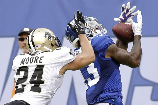 New Orleans Saints cornerback Sterling Moore defends New York Giants wide receiver Odell Beckham Jr., who drops a long pass in the fourth quarter in Week 2 of the NFL season on September 18, 2016 at MetLife Stadium in East Rutherford, New Jersey. File photo by John Angelillo/UPI