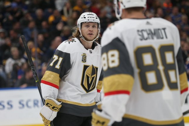 Vegas Golden Knights' William Karlsson of Sweden talks with teammate Nate Schmidt. Photo by BIll Greenblatt/UPI