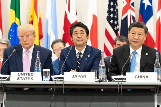 North Korea targeted Japan's military policy on Tuesday. Japanese Prime Minister Shinzo Abe (C) has yet to meet with Kim Jong Un. Photo by Shealah Craighead/White House