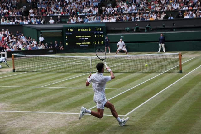 Roger Federer (top) lost to Serbian Novak Djokovic (bottom) in the Wimbledon men's singles final in 2019 at the All England Club in London. File Photo by Hugo Philpott/UPI
