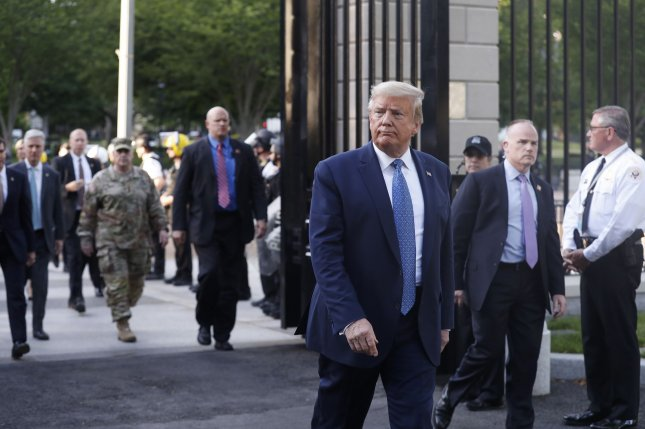 President Donald Trump returns to the White House on June 1 after posing with a Bible outside St. John's Episcopal Church in Washington, D.C. Mark Milley, chairman of the Joint Chiefs of Staff, is seen in military combat fatigues behind Trump. Photo by Shawn Thew/UPI