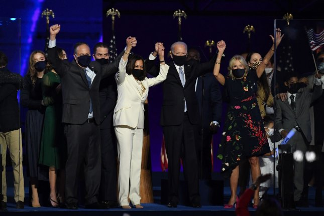 President-elect Joe Biden (2nd R), his wife, Jill Biden (R), Vice President-elect Kamala Harris (2nd L) and her husband, Douglas Emhoff, appear onstage after Biden defeated President Donald Trump in the 2020 presidential election, in Wilmington, Delaware, on November 7. File photo by Pat Benic/UPI