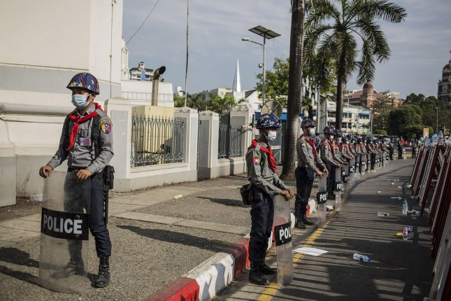 Riot police stand guard on a road during a demonstration against the military coup in Yangon, Myanmar, on Monday. Photo by Xiao Long/ UPI