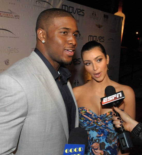 New Orleans Saints running back Reggie Bush and his girlfriend Kim Kardashian walk the red carpet at the Moves Magazine Super Bowl XLIII party in Tampa, Florida, on January 28, 2009. (UPI Photo/Roger L. Wollenberg)