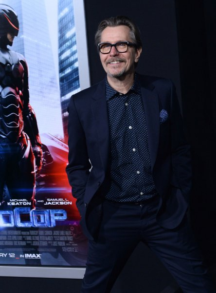 Cast member Gary Oldman attends the premiere of the sci-fi motion picture thriller Robocop at TCL Chinese Theatre in the Hollywood section of Los Angeles on February 10, 2014. Storyline: In 2028 Detroit, when Alex Murphy (Joel Kinnaman) - a loving husband, father and good cop - is critically injured in the line of duty, the multinational conglomerate OmniCorp sees their chance for a part-man, part-robot police officer. UPI/Jim Ruymen