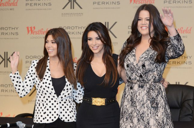American socialites/ TV stars Khloe Kardashian Odom, Kim Kardashian and Kourtney Kardashian attend a photo call to promote their Kardashian Kollection range at Westfield in London on November 10, 2012. UPI/Rune Hellestad