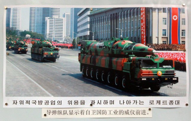 A photo of a mobile, long-range missile launcher is displayed on a picture board in front of the North Korean Embassy in Beijing. File Photo by Stephen Shaver/UPI