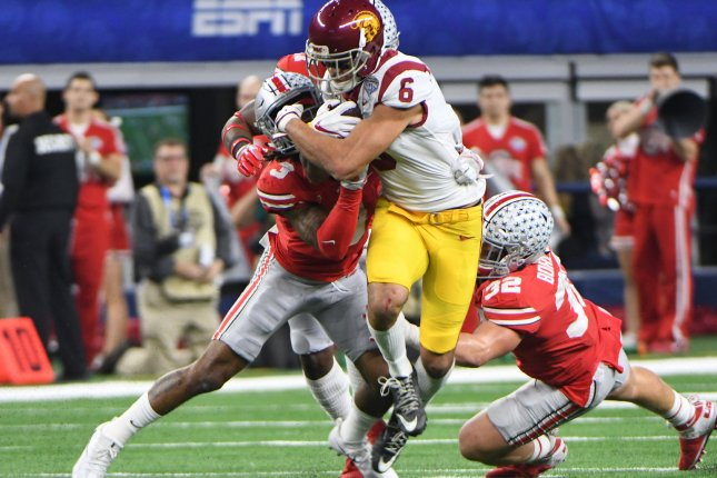 USC quartrback Sam Darnold gets wrapped up by the Ohio State defense during the first half of the Goodyear Cotton Bowl Classic on Friday at AT&T Stadium in Arlington, Texas. Photo by Ian Halperin/UPI