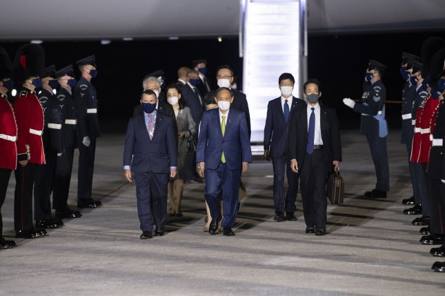 Japanese Prime Minister Yoshihide Suga and his wife, Mariko Suga, arrive at Cornwall Airport Newquay on Thursday, ahead of the G7 summit in Cornwall. File Photo by Doug Peters/G7 Cornwall 2021/UPI
