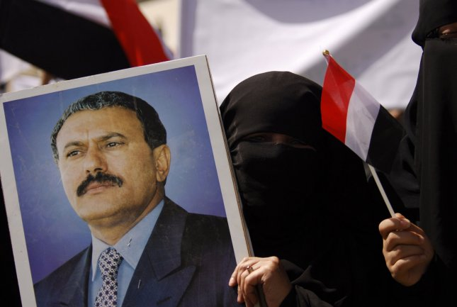 A portrait of President Ali Abdullah Saleh, who has yet to relinquish power despite recent injuries from a bombing at his compound. UPI/Mohammad Abdullah