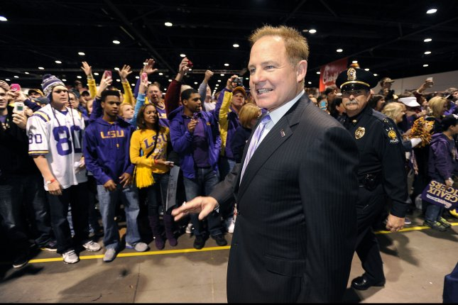 Former LSU head football coach Les Miles enters the Fan Fest at the Georgia World Congress Center prior to the LSU vs. Clemson Chick-fil-A Bowl game in Atlanta on December 31, 2012. UPI/David Tulis
