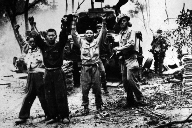 A U.S. Marine orders captured North Korean soldiers to keep their hands up in 1950. On July 27, 1953, a truce officially ended the Korean War. UPI FIle Photo