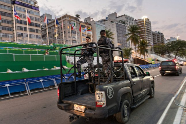 Brazilian army soldiers patrol Copacabana beach in Rio de Janeiro, Brazil. The army this week helped police capture one of Rio's most wanted fugitives. File Photo by Richard Ellis/UPI