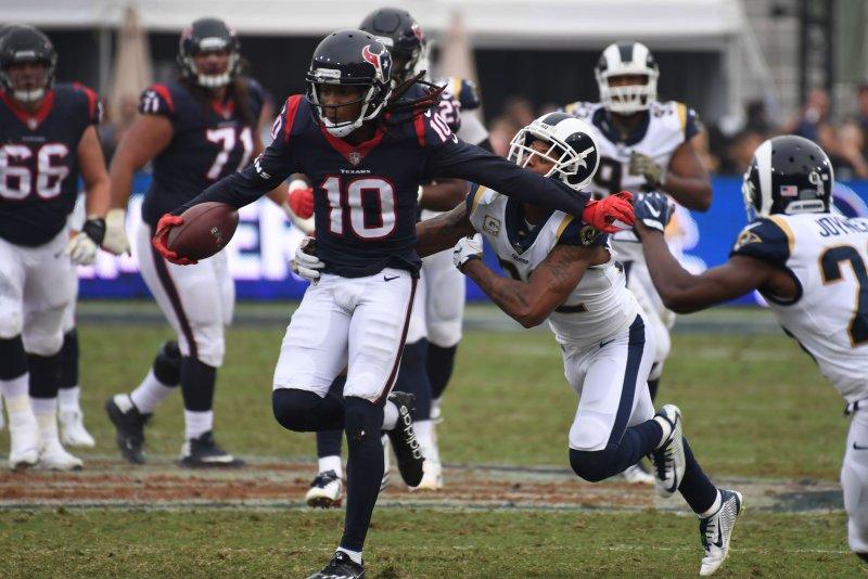 f96ba123b50 Houston Texans wide receiver DeAndre Hopkins (10) eludes the tackle of Los  Angeles Rams cornerback Trumaine Johnson (22) on November 12 at the LA  Coliseum ...