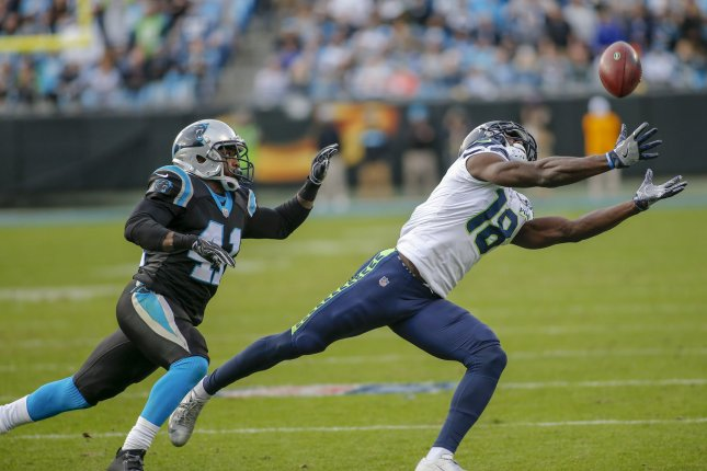 Seattle Seahawks wide receiver Jaron Brown misses a catch as Carolina Panthers defensive back Captain Munnerlyn (41) defends in the second half on Sunday in Charlotte, N.C. Photo by Nell Redmond/UPI