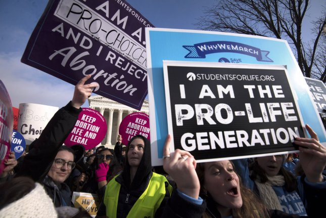 Advocates for both sides of the abortion issue square off at the Supreme Court during the March for Life anti-abortion rally, in Washington, D.C., on January 18. Photo by Kevin Dietsch/UPI