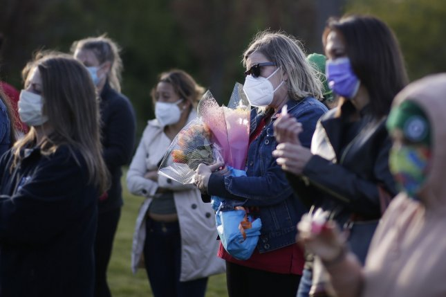 Nurses, elected officials and community members came together to commemorate the final day of nurses week with a vigil in Yonkers, N.Y., on May 12. On Wednesday, the United States surpassed 100,000 deaths from the novel coronavirus. Photo by John Angelillo/UPI
