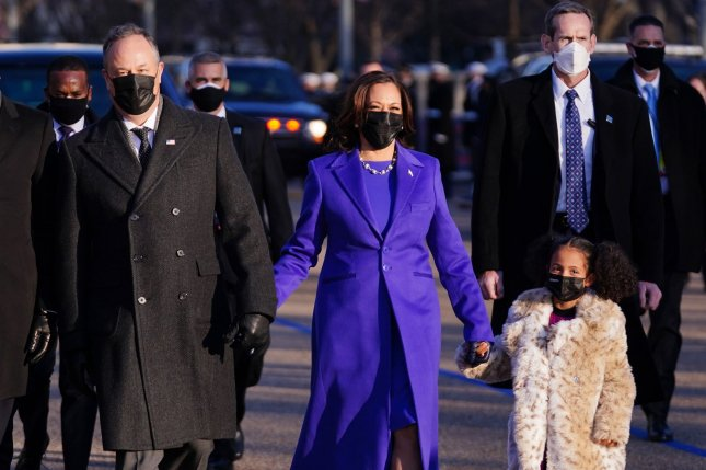 Vice President Kamala Harris holds hands with her grand-niece, Amala Ajagu, as she walks down Pennsylvania Avenue with her husband, Douglas Emhoff, and family after being sworn in at the Capitol in Washington, D.C., on Wednesday. Photo by Kevin Dietsch/UPI