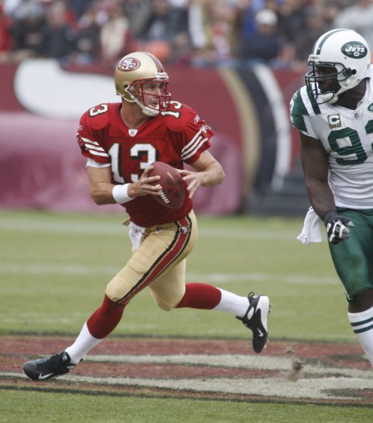 San Francisco 49ers QB Shaun Hill (13) runs away from New York Jets Shaun Ellis (R) in the third quarter at Candlestick Park in San Francisco on December 7, 2008. The 49ers defeated the Jets 24-14. (UPI Photo/Terry Schmitt)