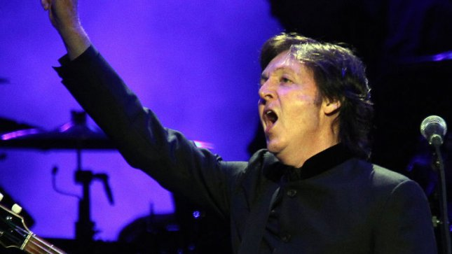 Paul McCartney waves to the crowd during his concert at the Scottrade Center in St. Louis on November 11, 2012. UPI/Bill Greenblatt
