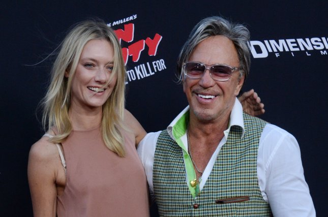Cast member Mickey Rourke and model Anastassija Makarenko attend the premiere of the motion picture crime thriller Sin City: A Dame to Kill For attends the premiere of the film at TCL Chinese Theatre in the Hollywood section of Los Angeles on August 19, 2014. Storyline: Co-directors Robert Rodriguez and Frank Miller reunite to bring Miller's Sin City graphic novels back to the screen. Weaving together two of Miller's classic stories with new tales, the town's most hard boiled citizens cross paths with some of its more notorious inhabitants. UPI/Jim Ruymen