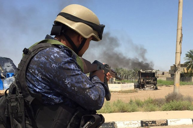 In this image, Iraqi soldiers during clash with Islamic State militants at Shuhadaa neighborhood in Fallujah, Iraq, June 7. The city of Fallujah was retaken by Iraqi security forces earlier this year -- aided by the U.S.-led anti-Islamic State coalition. On Wednesday, Iraqi security force took control of at least two villages in the Saladin Governorate's Sharqat district away from the Islamic State, which cut off a supply route to IS-held Mosul. File Photo by Abbas Mohammed/UPI