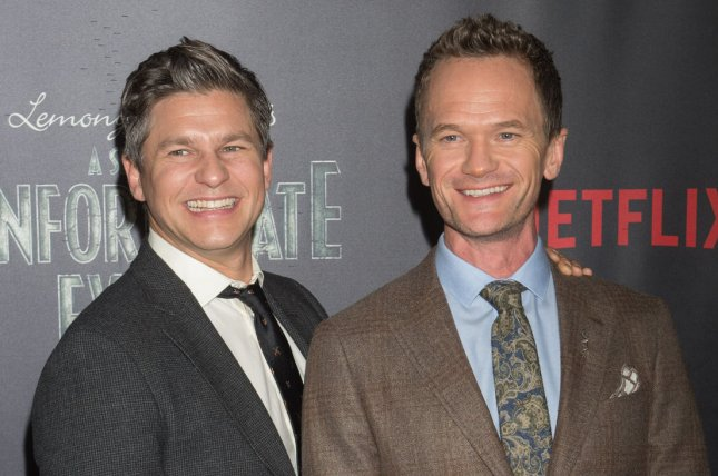 David Burtka (L) and Neil Patrick Harris arrive on the red carpet at the Netflix's premiere of A Series of Unfortunate Events on January 11 in New York City. File Photo by Bryan R. Smith/UPI