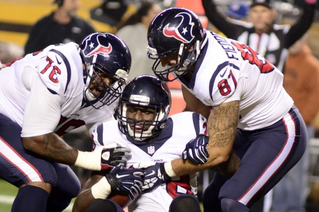 Houston Texans running back Alfred Blue (28) celebrates his touchdown with teammates, Houston Texans tight end C.J. Fiedorowicz (87) and Houston Texans tackle Duane Brown (76) in the first quarter at Heinz Field in Pittsburgh on October 20, 2014. File photo by Archie Carpenter/UPI