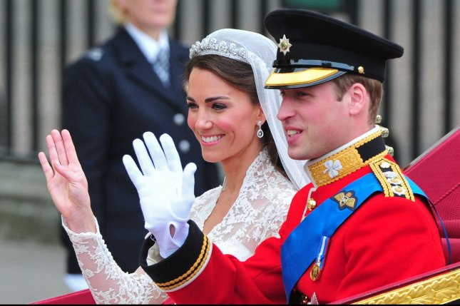 Prince William and his new wife, Kate Middleton, wave as they leave Westminster Abbey in a carriage following their wedding ceremony in London on April 29, 2011. File Photo by Kevin Dietsch/UPI