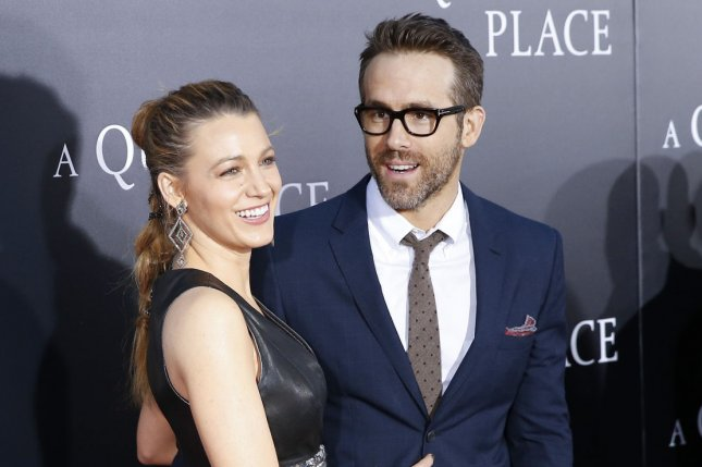 Blake Lively (L), pictured with Ryan Reynolds, commented Thursday after the actor visited Hugh Jackman at his coffee shop. File Photo by John Angelillo/UPI