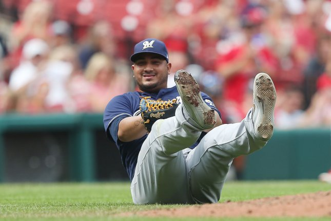 MIlwaukee Brewers starting pitcher Jhoulys Chacin sits on the infield grass after trying to thorw out St. Louis Cardinals Matt Carpenter at first base in the sixth inning on August 19 at Busch Stadium in St. Louis. Photo by Bill Greenblatt/UPI