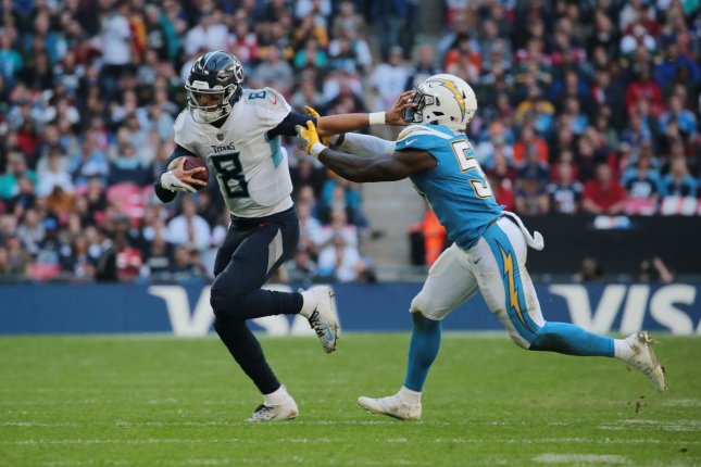 Tennessee Titans quarterback Marcus Mariota (8) runs with the ball against the Los Angeles Chargers on October 21 at Wembley Stadium in London. Photo by Hugo Philpott/UPI