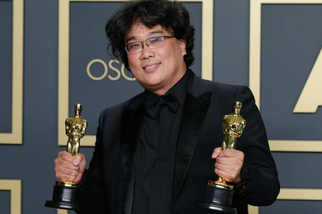 Bong Joon-ho, winner of Best Original Screenplay, Best Director and Best Picture for Parasite, appears backstage with his Oscars. Photo by John Angelillo/UPI