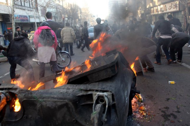 Iranian protesters set fires during an anti-government protest in Tehran, Iran on February 14, 2011. Last week protests led to the downfall of Egyptian President Hosni Mubarak's government. UPI/STR