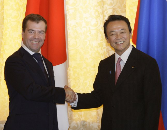 Russian President Dmitry Medvedev (R) shakes hands with Japanese Prime Minister Taro Aso before their meeting following the opening ceremony of the liquefied natural gas plant in Prigorodnoye, south of Sakhalin Island, in the Russian Far East, on February 18, 2009. (UPI Photo/Anatoli Zhdanov)