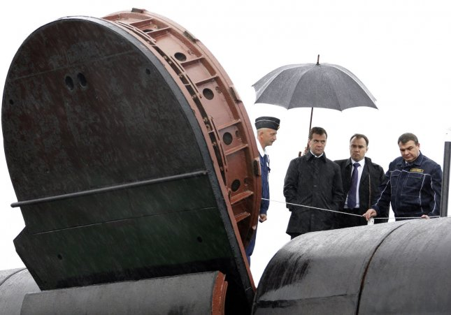 President Dmitry Medvedev (C) with Defense Minister Anatoly Serdyukov (R) visits the 'St. George the Victor' nuclear powered submarine at the Russian Pacific Fleet submarine base at Krasheninnikov Harbor on the Kamchatka Peninsula in the Russian Far East on September 25, 2008. (UPI Photo/Anatoli Zhdanov)