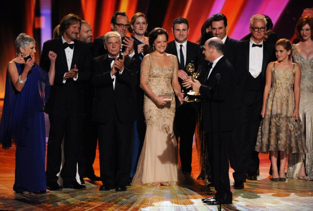 Writer and producer Matthew Weiner of Mad Men accepts the outstanding drama series award, surrounded by cast members during the 63rd annual Primetime Emmy Awards held at Nokia Theatre in Los Angeles on September 18, 2011. UPI/Jim Ruymen