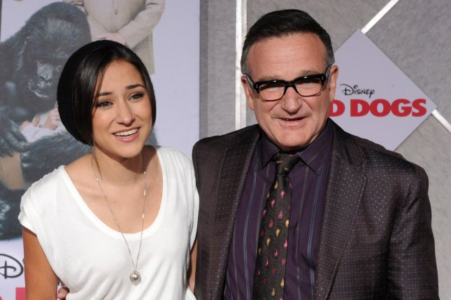 Zelda Williams (L) honored father Robin Williams with two memorial tattoos. (UPI/Jim Ruymen)