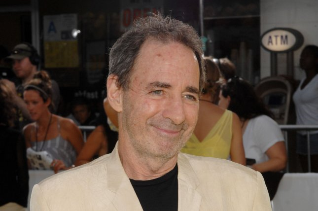 Harry Shearer, the voices including Mr. Burns, Ned Flanders, Principal Skinner, Rev. Lovejoy and President Arnold Schwarzenegger in the animated motion picture comedy The Simpsons Movie, arrives at the premiere of the film in the Westwood section of Los Angeles on July 24, 2007. Longtime 'The Simpsons' cast member Harry Shearer will be remaining on the show (UPI Photo/Jim Ruymen)