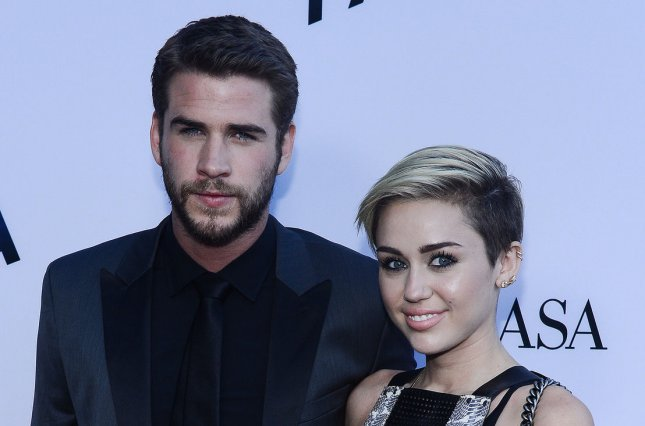 Miley Cyrus (R) and Liam Hemsworth at the Los Angeles premiere of Paranoia on August 8, 2013. File Photo by Jim Ruymen/UPI